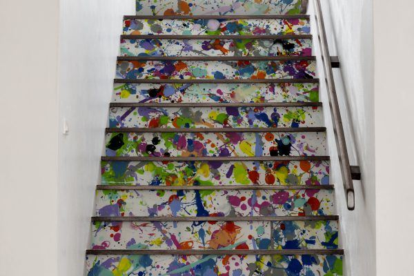 A fun brightly coloured paint splattered Jackson Pollock inspired wall covering