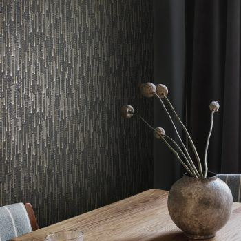metallic wallcovering with deeply textured vertical stacked blocks which catch the light from every angle in a hotel interior